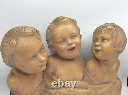 Sculpture bustes Trois enfants rieurs en terre cuite signé R. Pollin Art Déco