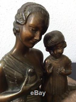 Sculpture régule patiné Femme et fille à loiseau signé Molins Balleste Art Déco