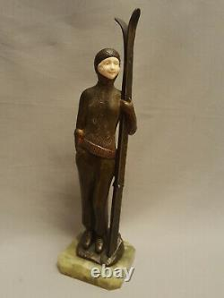 Skier chryséléphantine skieuse sculpture en bronze art déco